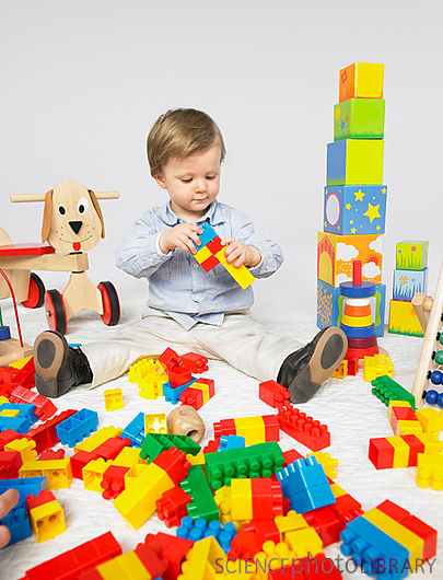 Toddler with many toys