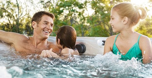 Father With HIs Two Kids in A 4 person Hot tub