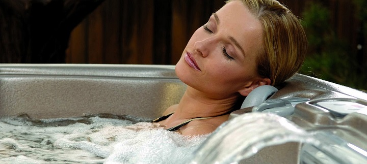 Women Relax In 4 Person Spas