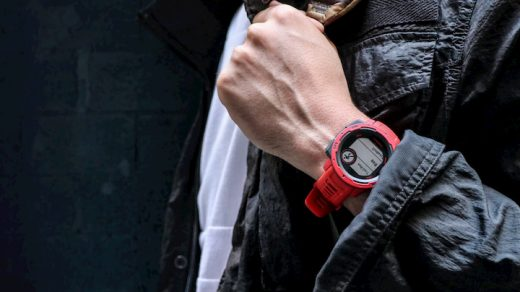 man with red garmin watch on his hand