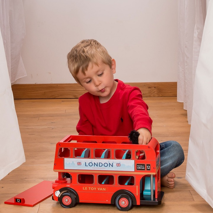 Boy Playing with Le Toy Van Toys