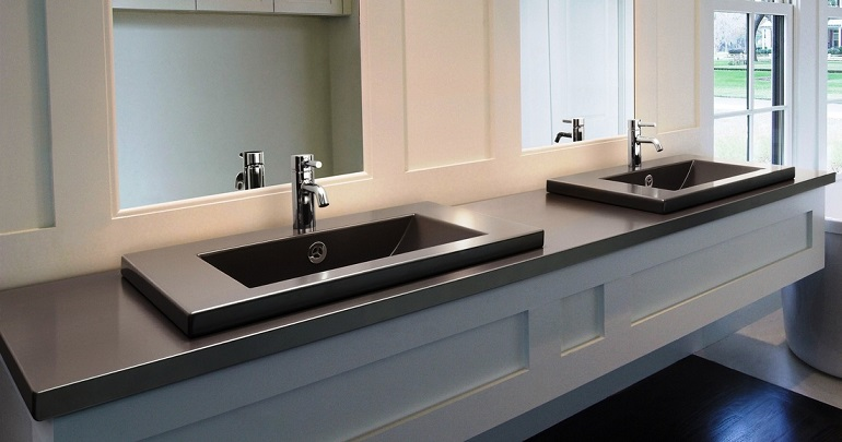 picture of modern white bathroom with dark vanity basins