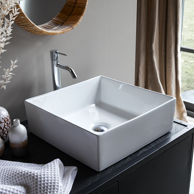 picture of a bathroom with white square ceramic basin