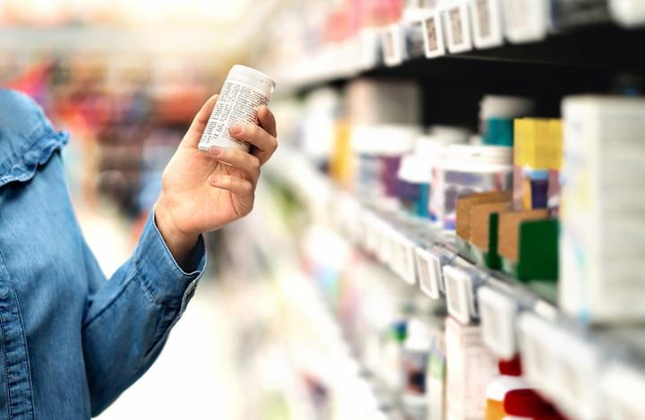 holding-medication-bottle-in-drugstore