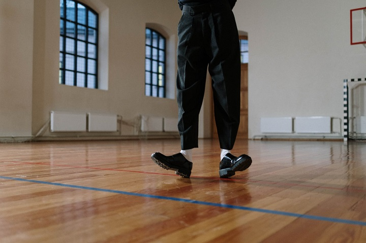 picture of a person in a hall dancing in tap shoes