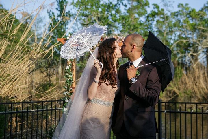 Bride and groom with wedding umbrellas
