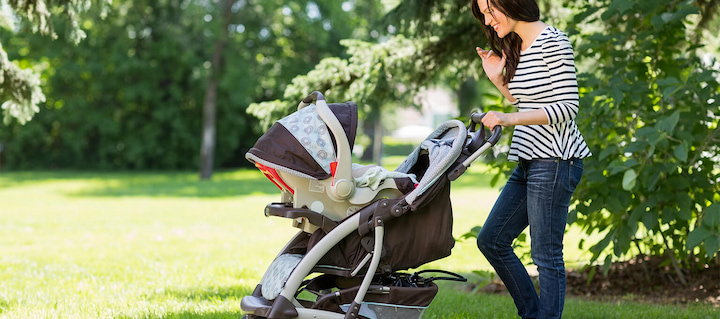 mother and the stroller with the baby